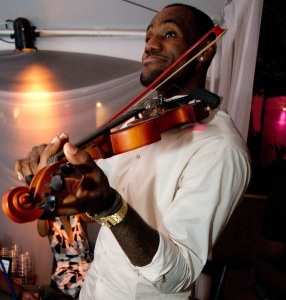 LeBron and Chris playing violin and singing.